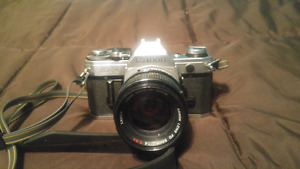 Cannon AE-1 with extra lenses