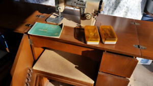 Vintage white sewing machine with cabinet and stool