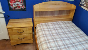 Twin captains bed with night stand.