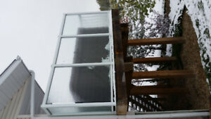 Glass railing / wind wall for hot tub deck