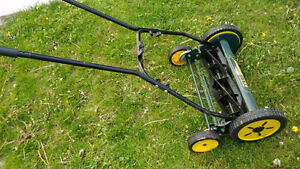 Manual Lawn Mower almost new.