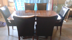Antique dining table with  6 modern chairs