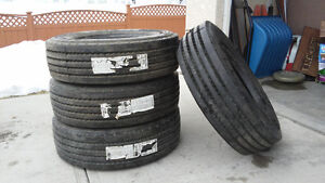 NEVER BEEN MOUNTED 4 NEW HEAVY DUTY TRAILER TIRES.