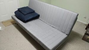 Nice Clean Futon with Quilted Cover and matching Pillow