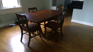 drop- and butterfly-leaf dining table and four chairs