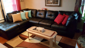 2 year old black leather 2 pc sectional very comfy good cond
