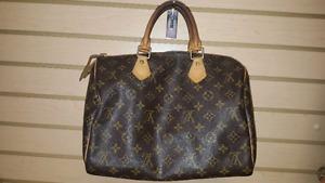 Louis Vuitton Speedy 30 and Wilshire p.m. handbags.