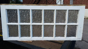 Antique window with rolled glass
