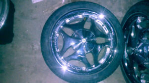"""17"""" chrome rims with tires."""