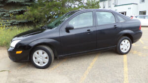 07 Focus - auto - 4 dr -  LOADED - A/C - NEW TIRES - ONLY 117KMS
