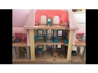 Little tikes doll house.