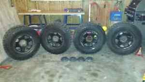 Selling a set of goodyear wrangler and a rims for a Toyota Tacom