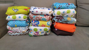 32 Cloth diapers. 64 Liners. 3+ rolls disp liners