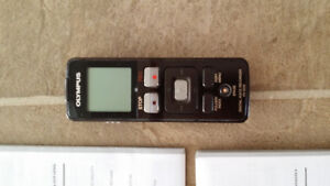 Olympus digital recorder with manual.