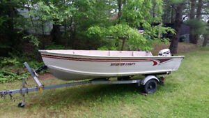 14 Ft Smoker Craft Boat, 9.9 HP Johnson Motor, EZ Loader Trailer