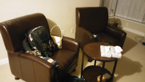 2 brown leather sofa chairs