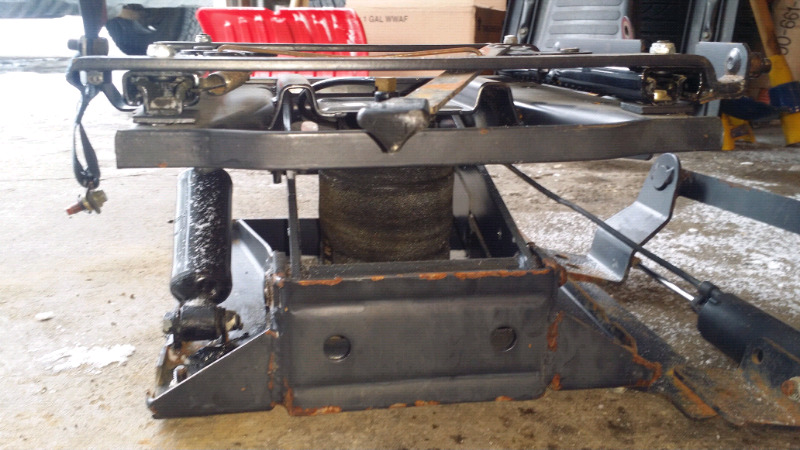 National self contained air ride seat base with pump