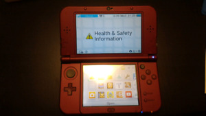 """""""new"""" Nintendo 3ds xl red with 7 games"""