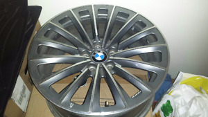 Four  staggered 19 inch stock bmw perforance rims