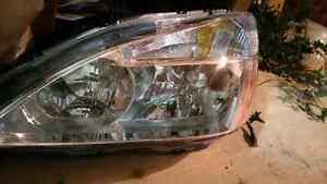 Like new 2003-2007 Honda Accord Driver's side headlight housing Regina Regina Area image 2
