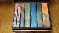 mint unread first edition harry potter books in a case