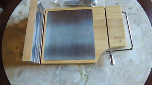 Very nice cheese board with built in cutter