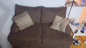 Chocolate brown love seat, free delivery.