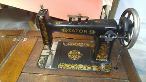 T EATON antique sewing machine in oak cabinet London Ontario image 1