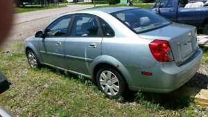 05 Chevy Optra 4cyl auto ( good parts car )