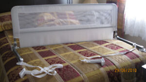 Two Bed Rails for sale ,one to fit a double bed or queen bed $40