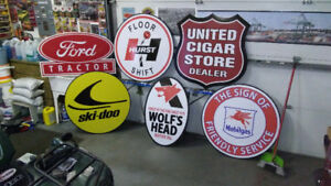 LARGE METAL SKIDOO AND GASOLINE SIGNS