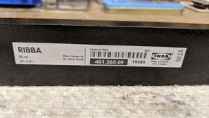 Two Ikea RIBBA black shelves