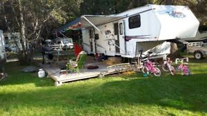 SOLD....Trailer with Deck/Fence at beautiful Pinecone Campground
