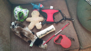 Dog toys, 2 brand new  harnesses, dog collar , retractable leash