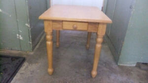 solid wood table with small drawer