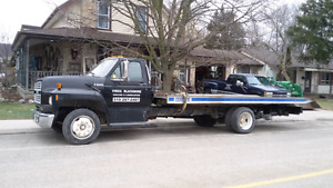 1993 ford 600. 18ft tilt and load with a wheel lift stinger
