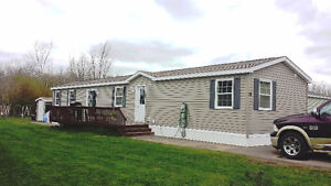 BEAUTIFUL MINI HOME IN PARK, WALKING TRAILS BEHIND YOU