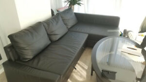 Corner couch - storage and extends to a bed - great condition