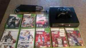 4GB Xbox 360 with 8 games and wireless controller.