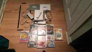 Wii console with 6 game's and guitar Hero