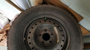 Four Snow Tires on Steel Rims - Size P215/65R15
