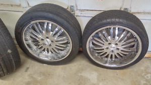 4 Chrome rims. with tires