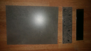 Wall tile, decorative tile glue and spacers.