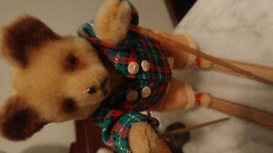 Old wind-up Teddy Bear on skis