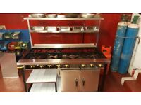 New, 9 burner with 1 oven gas cooker. Indian restaurant cooker