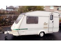 Elldis 2 berth caravan complete set up with awning and motor mover