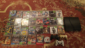 PS3 Slim 320gb w/3 controllers and 30 games.