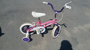 Girl's bike with training wheels. wheel size 12