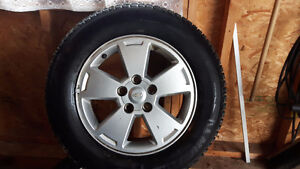 225/60R15 Michelin X ice 3 winter tires on factory alloy rims.