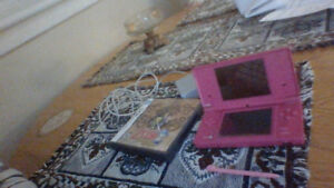 Pink Nintendo DS system and 2 games